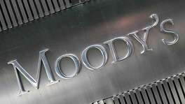 Moody's said Friday that the U.S. Department of Justice is preparing a civil complaint alleging violations of the Financial Institutions Reform, Recovery and Enforcement Act.