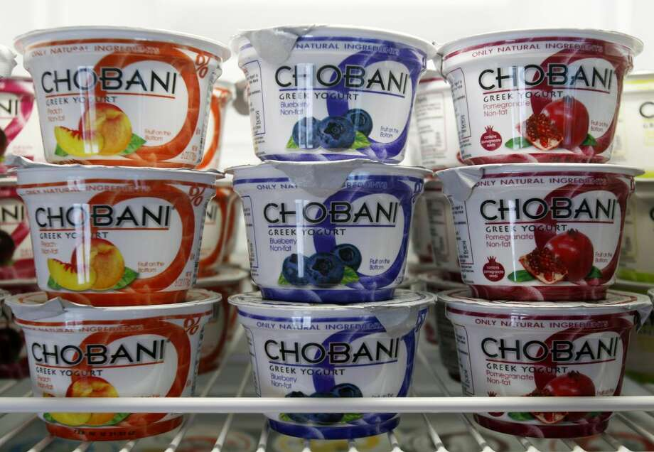 In this Jan. 13, 2012, file photo, Chobani Greek Yogurt is seen at the Chobani plant in South Edmeston, N.Y. Chobani says it's issuing a recall of some of its Greek yogurt cups that were affected by mold, according to the company, Thursday, Sept. 5, 2013. The recall comes after some customers reported claims of illnesses. (AP Photo/Mike Groll, File)