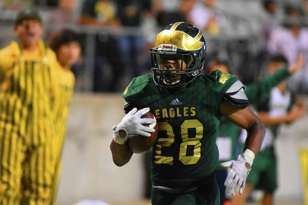 Cy Falls senior running back Christian Anderson rushes for a touchdown in Thursday's 42-38 victory over Jersey Village. Anderson was a juggernaut for the Golden Eagles, racking up 283 all-purpose yards and three touchdowns on 15 rushes, six receptions and two kick returns.