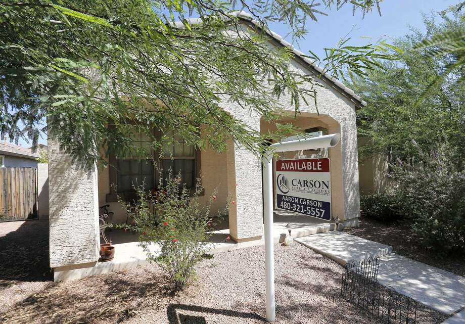 In this Tuesday, July 30, 2013, file photo, a realty sign hangs in front of a home for sale in Gilbert, Ariz. Standard & Poor's/Case-Shiller reports on home prices in July on Tuesday, Sept. 24, 2013. (AP Photo/Matt York, File)