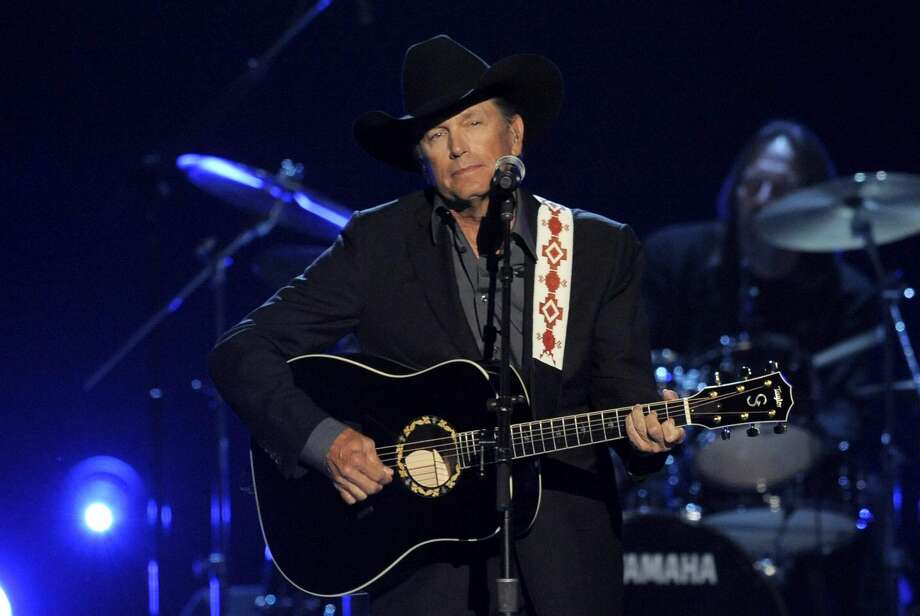 This April 7, 2013 file photo shows George Strait performing at the 48th Annual Academy of Country Music Awards at the MGM Grand Garden Arena in Las Vegas. Strait will finish off his two-year farewell tour in the biggest house in his home state of Texas — the Dallas Cowboys' AT&T Stadium. The country superstar held a rare news conference Monday, Sept. 9, at the stadium to announce the last leg of his The Cowboy Rides Away tour. He announced he was retiring from the road last year, but still plans to record, recently agreeing to a deal for five more studio albums. (Photo by Chris Pizzello/Invision/AP, File)