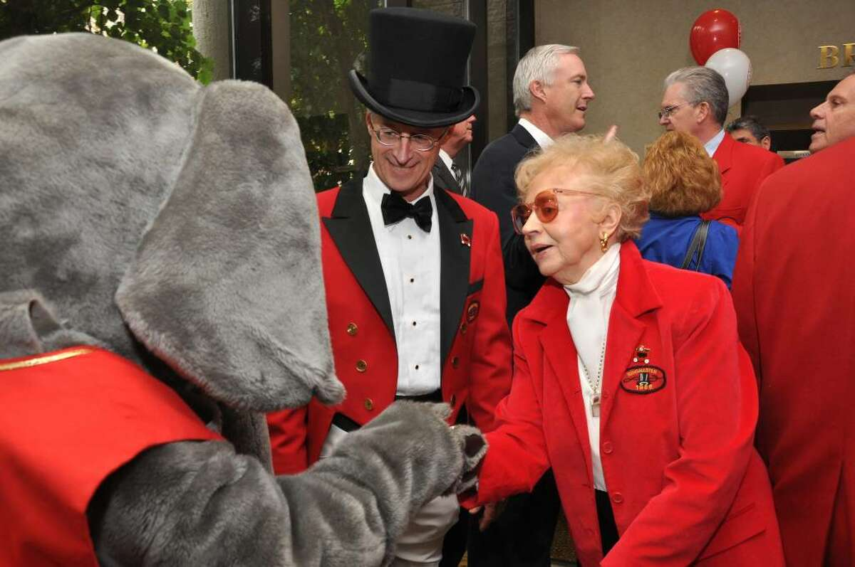 Barnum Festival Ringmaster Tom Santa smiles as Elizabeth Pfriem, Ringmaster 1986, greets Spirit the elephant during the Whip, Whistle and Watch luncheon on Friday, May 14, 2010.