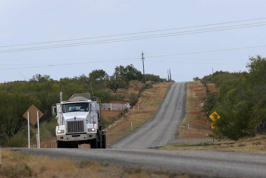 Oil-field related traffic moves on FM 469 in La Salle County, north west of Cotulla, Texas, Tuesday, Sept. 10, 2013.