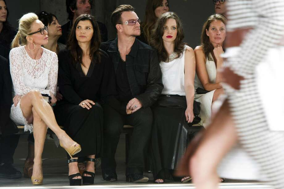 Trudie Styler, from left, Ali Hewson, Bono, Jordan Hewson and Christy Turlington Burns attend the Edun collection on Sunday, Sept. 8, 2013, during Mercedes-Benz Fashion Week in New York. (Photo by Charles Sykes/Invision/AP)