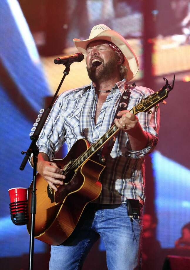 In this July 6, 2013, file photo, Toby Keith performs at the Oklahoma Twister Relief Concert at the Gaylord Family-Oklahoma Memorial Stadium in Norman, Okla. The tornado relief concert organized by Keith has raised $2 million that will go to a tornado relief fund run by the United Way of Central Oklahoma. (Photo by Alonzo Adams, File/Invision/AP, File)