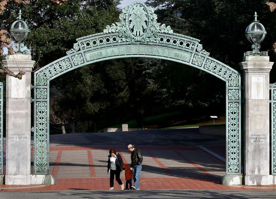 Visitors walk through Sather Gate at UC Berkeley. Photo: Paul Chinn, The Chronicle
