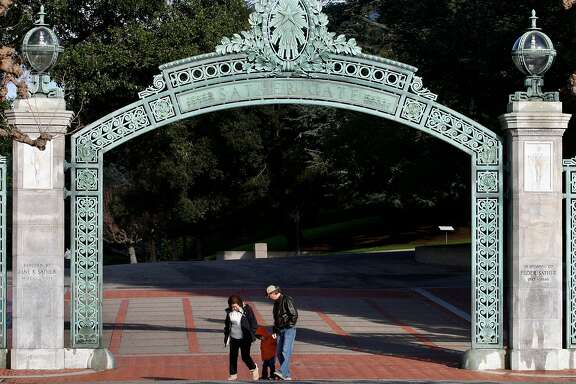 Visitors walk through Sather Gate at UC Berkeley on Wednesday, Dec. 29, 2010.