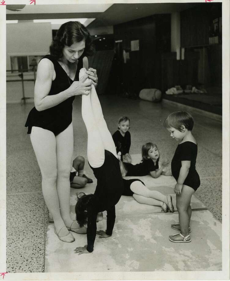 "05/15/1966 - Dance instructor Patsy Swayze works with her ""baby dance class,"" which includes children with special needs. The students bounce, hop, skip - and purposely learn to fall. Swayze spots a student on her palms for a handstand while her classmate eagerly awaits her turn."
