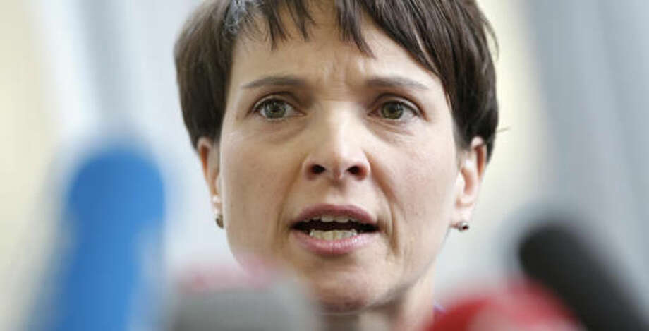 """FILE - In this Feb. 22, 2016 file picture Frauke Petry, Chairwoman of the AfD, Alternative fuer Deutschland (Alternative for Germany), party addresses the media during a press conference in Berlin. A leading member of the nationalist party Alternative for Germany is facing fierce criticism after calling for a racially charged term once favored by the Nazis to be rehabilitated. Party co-chairwoman Frauke Petry said in an interview published Sunday Sept. 11, 2016 that words such as """"voelkisch"""" should be given """"a positive connotation."""" Frequently used by the Nazis, the term refers to people who belong to a particular race. (AP Photo/Michael Sohn,file)"""