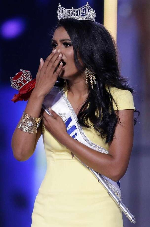 Miss New York Nina Davuluri reacts after being crowned as Miss America 2014 on Sunday, in Atlantic City, N.J. (AP Photo/Julio Cortez)