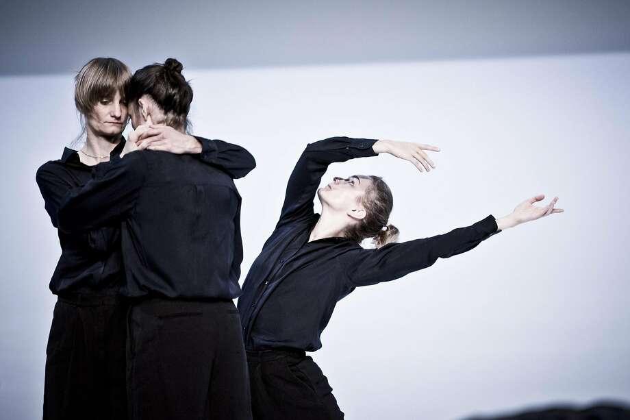 "Vera Nevanlinna (left), Alexandra Campbell and Unn Faleide of the Cullberg Ballet dance in Deborah Hay's ""Figure a Sea,"" at Berkeley's Zellerbach Hall. Photo: Photograph By (copyright)� Urban Loren"