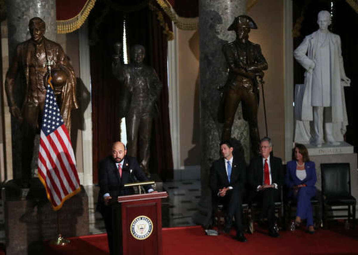 Ohio House of Representatives Speaker Cliff Rosenberger, left, with, seated, from left, House Speaker Paul Ryan of Wis., Senate Majority Leader Mitch McConnell of Ky., and House Minority Leader Nancy Pelosi of Calif., speaks during the unveiling of the statue of Thomas Edison in Statuary Hall on Capitol Hill in Washington, Wednesday, Sept. 21, 2016. (AP Photo/Manuel Balce Ceneta)
