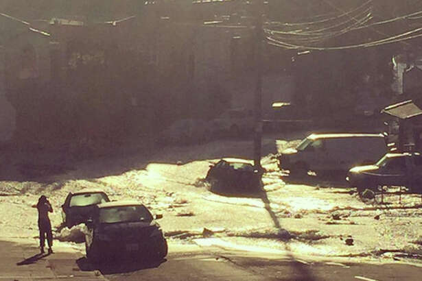 Flooding at Montana and Adell streets this morning in the Dimond district of Oakland.