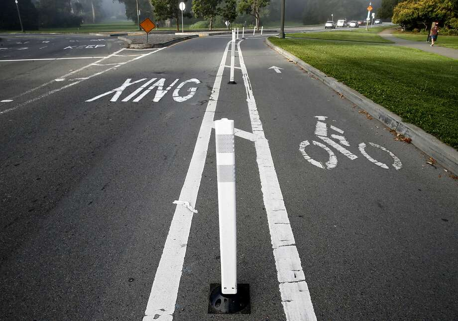 A bike lane is separated from traffic by flexible plastic posts on John F. Kennedy Drive at Golden Gate Park in San Francisco, Calif. on Friday, Oct. 21, 2016. The posts were apparently installed illegally by so-called traffic safety vigilantes. Photo: Paul Chinn, The Chronicle