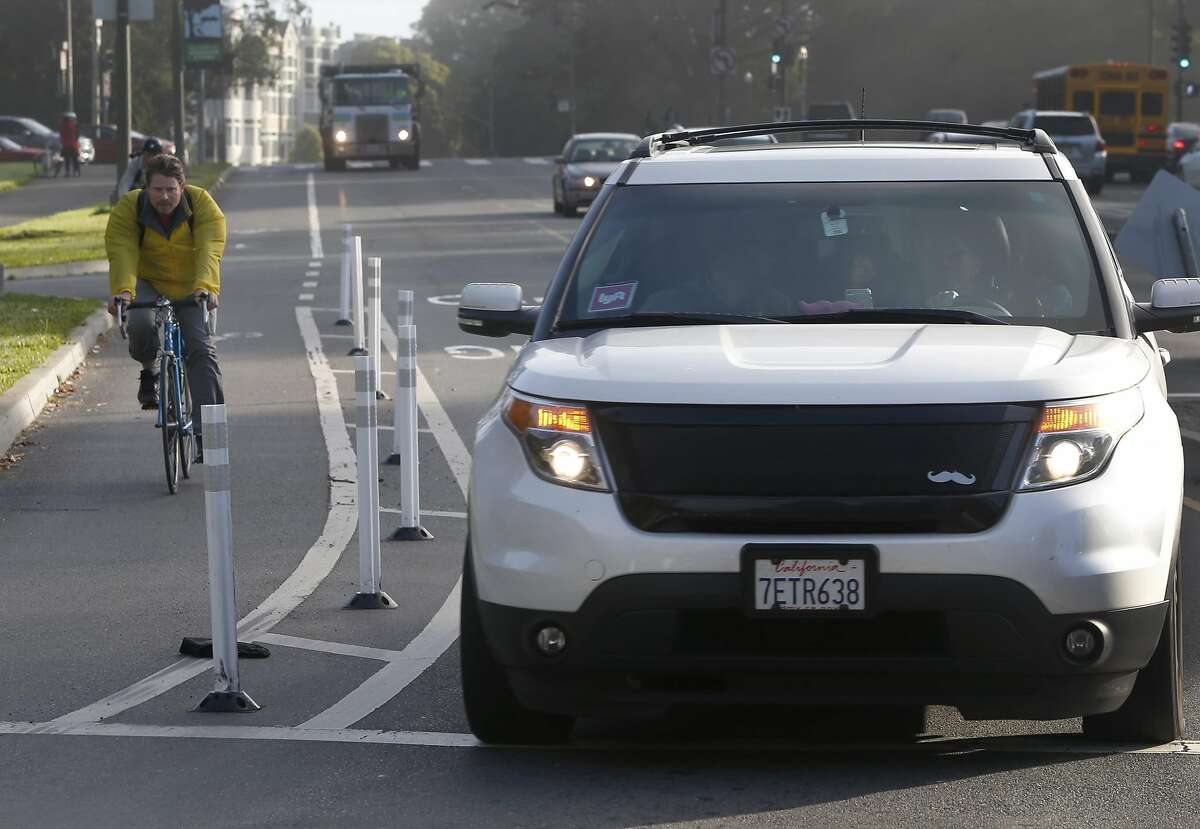 A bike lane is separated from traffic by flexible plastic posts on John F. Kennedy Drive at Golden Gate Park in San Francisco, Calif. on Friday, Oct. 21, 2016. The posts were apparently installed illegally by so-called traffic safety vigilantes.
