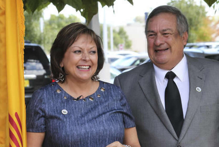 New Mexico Gov. Susana Martinez and Los Lunas Mayor Charles Griego celebrate a decision by Facebook to locate its newest data center in the state during an event in Los Lunas, N.M., on Thursday, Sept. 15, 2016. Martinez said New Mexico would not have been on the radar of the social media giant had it not been for a meeting she had with executives in August 2015. (AP Photo/Susan Montoya Bryan)