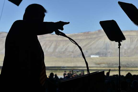 """(FILES) This file photo taken on October 18, 2016 shows Republican presidential nominee Donald Trump speaking during a rally at West Star Aviation in Grand Junction, Colorado on October 18, 2016. Republican candidate Donald Trump has made the insistent claim that the US presidential elections are being """"rigged,"""" but experts say massive voter fraud is highly unlikely in a system as decentralized as the United States. """"There are a lot of safeguards in place that would preclude that from happening, from federal laws to local and state laws as well,"""" said Jo-Renee Formicola, a political scientist at Seton Hall University.  / AFP PHOTO / Mandel NganMANDEL NGAN/AFP/Getty Images"""