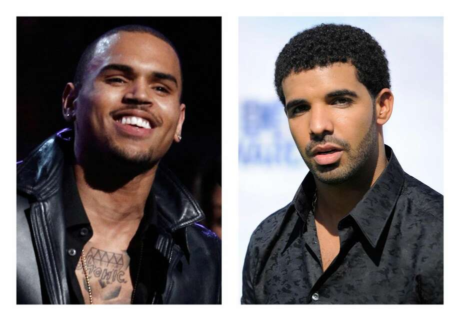 This combination of 2012 and 2011 file photos shows hip hop stars Chris Brown, left, and Drake. New York City police investigated a report Thursday of a bar brawl involving hip-hop stars Drake and Chris Brown and their entourages in which bottles flew and five people were injured. (AP Photo/Matt Sayles, Chris Pizzello)