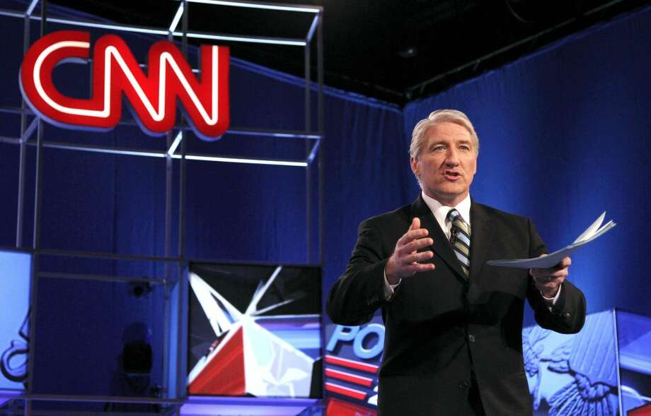 "This Feb. 22, 2012 file photo shows moderator and CNN correspondent John King. CNN is canceling John King's evening news show, making him the first victim of the network's bad stretch in the ratings. ""JK USA"" has aired at 6 p.m. ET since 2010. CNN said Wednesday that Wolf Blitzer's ""Situation Room"" would expand to three hours, and King will become the network's lead national campaign correspondent. (AP Photo/Ross D. Franklin, file)"