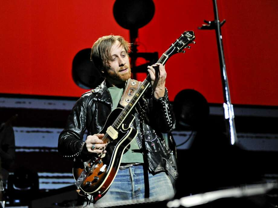 "In this March 12, 2012 file photo, guitarist/vocalist Dan Auerbach of The Black Keys performs at Madison Square Garden, in New York. The Black Keys sued Pizza Hut and Home Depot on June 22, 2012, in Los Angeles, claiming the corporations violated their copyrights by using elements of their songs ""Gold on the Ceiling"" and ""Lonely Boy"" in advertisements. (AP Photo/Evan Agostini, File)"