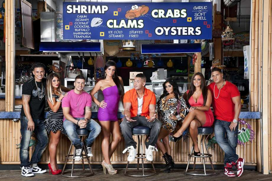 """This undated image released by MTV shows the cast of """"Jersey Shore,"""" from left, Paul """" DJ Pauly D"""" Delvecchio, Deena Nicole Cortese, Vinny Guadagnino, Jenni """"JWOWW"""" Farley, Mike """"The Situation"""" Sorrentino, Nicole """"Snooki"""" Polizzi, Sammi """"Sweetheart"""" Giancola and Ronnie Magro in Seaside Heights, N.J. The cast of MTV's reality series """"Jersey Shore"""" moved into their summer rental in Seaside Heights to begin taping the 6th season Thursday. (AP Photo/MTV, Ian Spanier Photography)"""