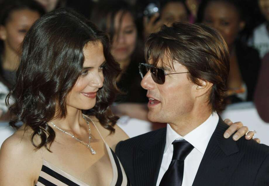 In this Wednesday, May 26, 2010 photo, Tom Cruise, right, poses with his wife Katie Holmes pose for the photographers as they arrive for the National Movie Awards at the Royal Festival Hall, in London. Holmes' attorney Jonathan Wolfe said Friday June 29, 2012 that the couple is divorcing, but called it a private matter for the family. (AP Photo/Lefteris Pitarakis, File)