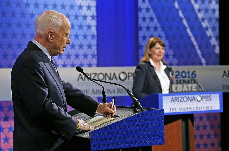 Incumbent Sen. John McCain, R-Ariz., left, faces off against his re-election opponent, Democratic Rep. Ann Kirkpatrick, on Oct. 10 in Phoenix. Photo: Ross D. Franklin, Associated Press