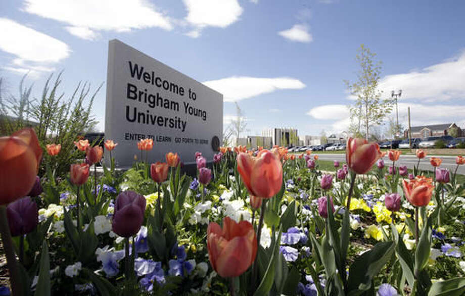 FILE - This April 19, 2016, file photo, shows a welcome sign to Brigham Young University in Provo, Utah. Utah public records officials are ordering the Provo and Orem police departments to release a report showing any time a Brigham Young University employee accessed police records. The Salt Lake Tribune reports the records committee ordered the police departments to release a report showing when BYU workers in the past year and a half accessed a police database. (AP Photo/Rick Bowmer, File)