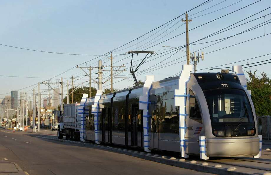 Testing of the Metro light rail along Harrisburg Blvd. is shown Oct. 21 in Houston. The Harrisburg overpass of the freight rail tracks near Hughes is the final piece of Metro's Green Line. Photo: Melissa Phillip, Houston Chronicle / © 2016 Houston Chronicle