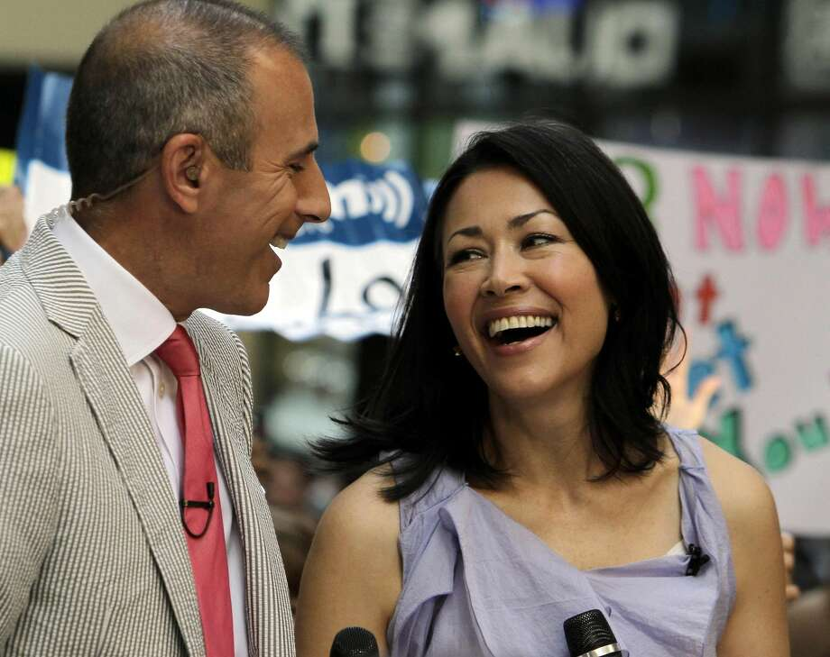 """In this July 22 file photo, NBC """"Today"""" television program co-hosts Matt Lauer and Ann Curry appear during a segment of the show in New York. A source with knowledge of the show who spoke on condition of anonymity because the source was not authorized to speak on the matter said Wednesday that NBC is discussing a plan to ease Curry out of the co-hosting role. (AP Photo/Richard Drew, File)"""
