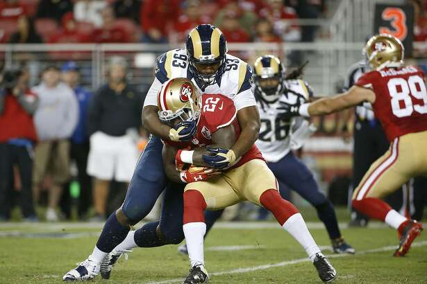 Los Angeles Rams defensive tackle Ethan Westbrooks (93) tackles San Francisco 49ers running back Mike Davis during the second half of an NFL football game in Santa Clara, Calif., Monday, Sept. 12, 2016. (AP Photo/Tony Avelar)