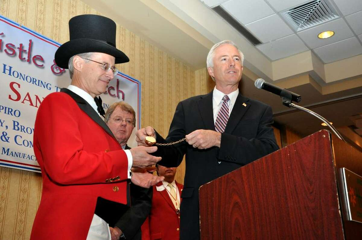 Mayor Bill Finch, City of Bridgeport, presents 2010 Barnum Festival Ringmaster Tom Santa with the watch during the Whip, Whistle and Watch luncheon on Friday, May 14, 2010.