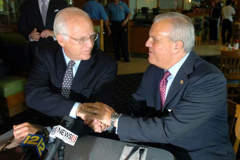 Former Congressman Christopher Shays shakes hands with Lt. Governor Michael Fedele during a press conference at the Circle Diner, in Fairfield, Conn. Friday, May 14th, 2010. Shays announced his endorsement for Fedele's campaign for Governor. Photo: Ned Gerard / Connecticut Post