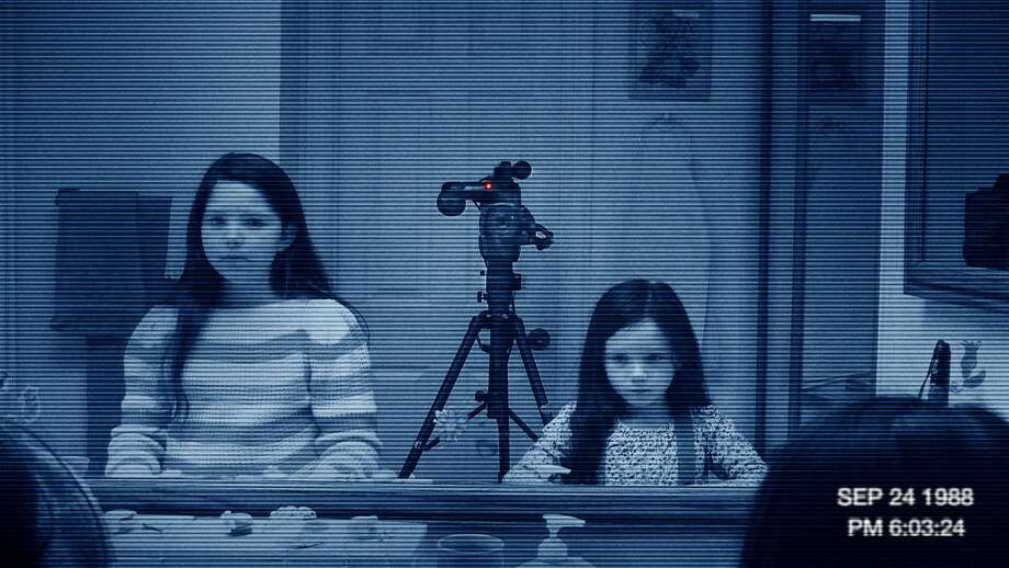 "A scene is shown from the film ""Paranormal Activity 3,"" which topped the box office over the weekend with $54 million. (AP Photo/Paramount Pictures)"