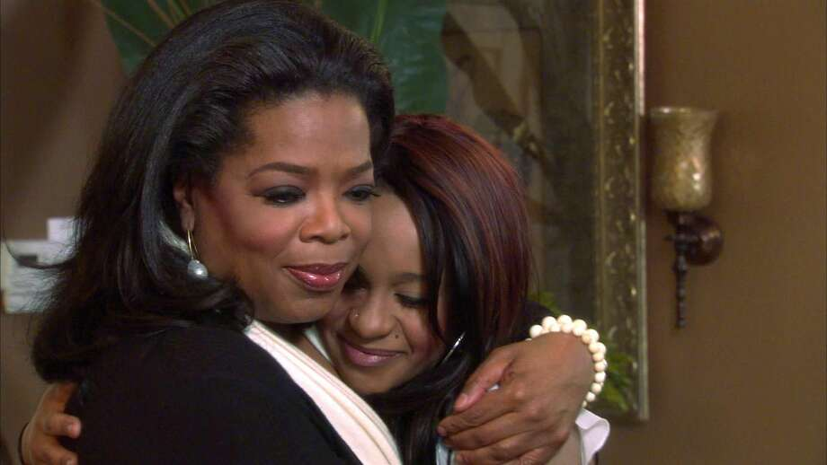 "An undated image from video originally released by Harpo, Inc., shows host Oprah Winfrey, left, embracing Bobbi Kristina, daughter of the late singer Whitney Houston during an interview in Atlanta, Ga. The exclusive interview was shown on ""Oprah's Next Chapter,"" on the OWN network on March 11, 2012. (AP Photo/Harpo, Inc., file)"