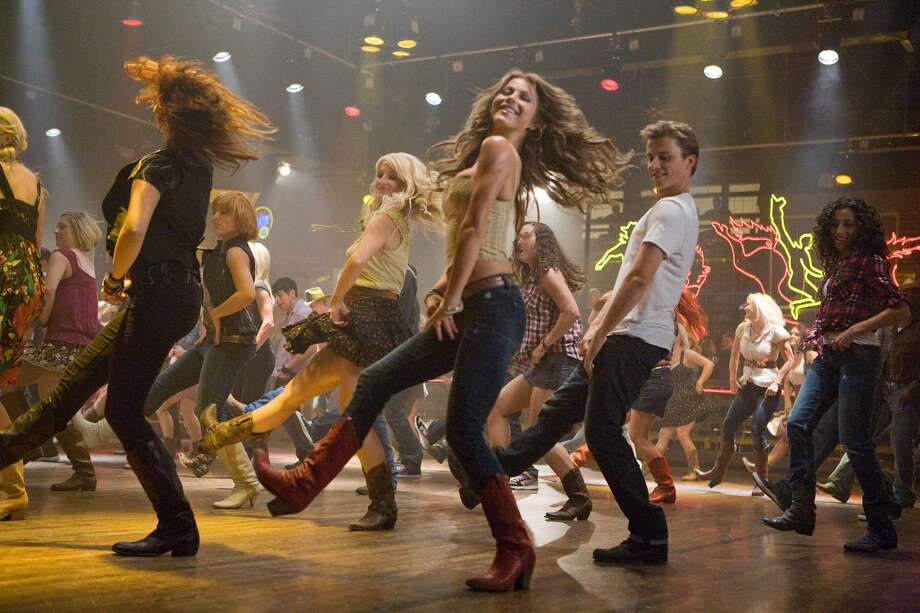 "Julianne Hough, center, and Kenny Wormald are shown in a scene from ""Footloose."" The robot boxers of ""Real Steel"" and the dancers of ""Footloose"" are in a tight fight for the box-office title. ""Real Steel"" came in barely ahead of the remake ""Footloose"", which opened with $16.1million.(AP Photo/Paramount Pictures, K.C. Bailey)"