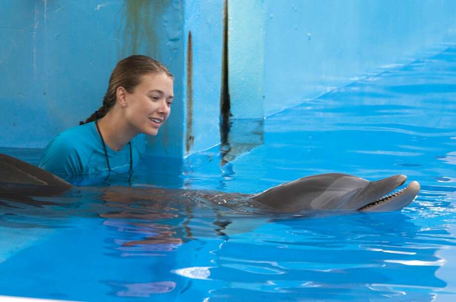 "Austin Highsmith is seen here in the role of Phoebe in ""Dolphin Tale."" ""Dolphin Tale"" dethroned ""The Lion King"" in the weekend box office. The ""Dolphin Tale"" held up well with $14.2 million in its second weekend. (AP Photo/Jon Farmer, Alcon Entertainment)"