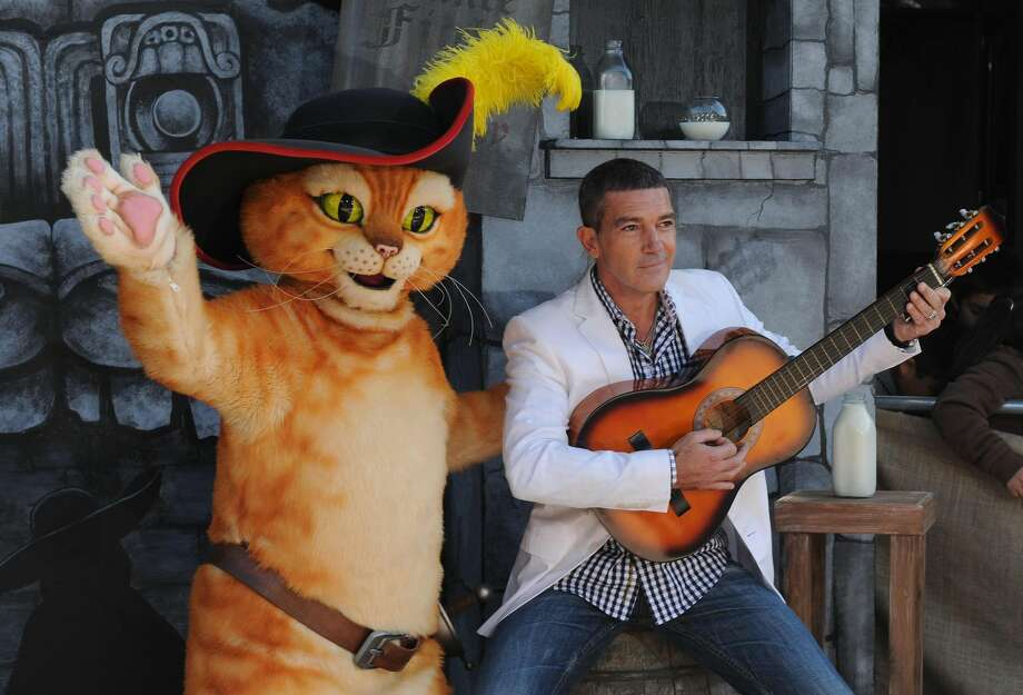 "Antonio Banderas arrives at the premiere of ""Puss In Boots,"" Sunday, Oct. 22, at The Regency Village Theater in Los Angeles. ""Puss In Boots"" opened to a $34 million weekend and tops at the box office. (AP Photo/Katy Winn)"