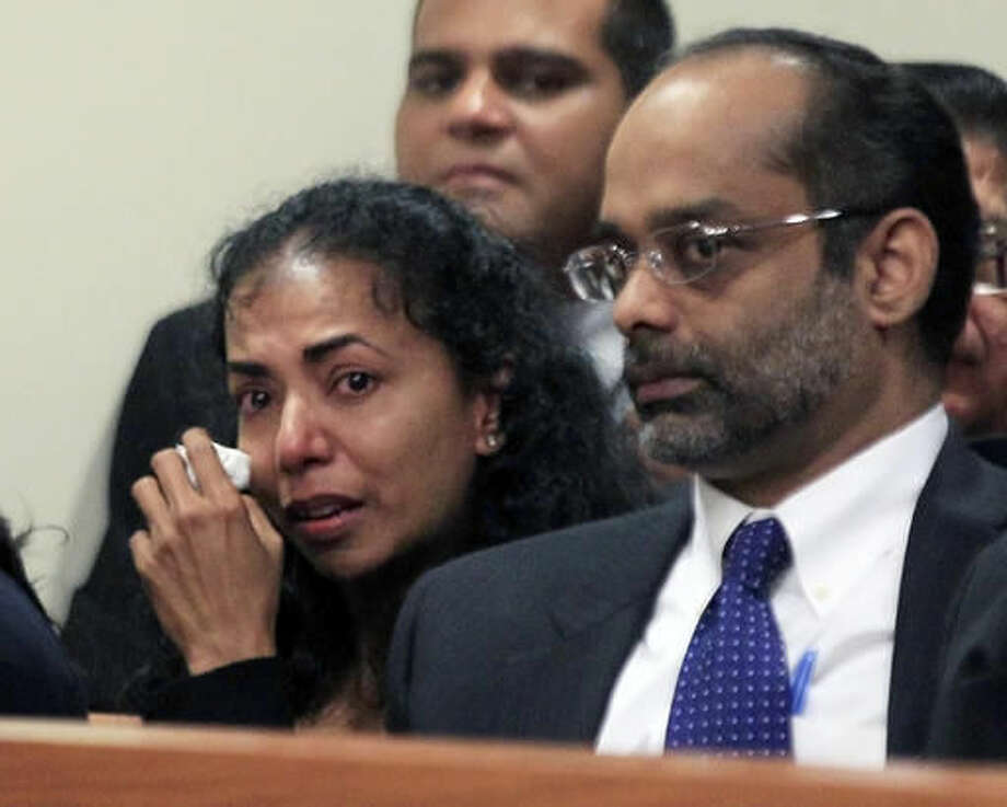 FILE - In this May 21, 2012, file photo, Ravi Pazhani, front right, sits with his crying wife, Sabitha Ravi, front left, at a sentencing hearing for their son Dharun Ravi in New Brunswick, N.J. In a Friday, Sept. 9, 2016, ruling, a New Jersey appeals court threw out the 15-count conviction of former Rutgers University student Dharun Ravi, whose roommate Tyler Clementi killed himself in 2010 after being captured on a webcam kissing another man. (AP Photo/Mel Evans, File)
