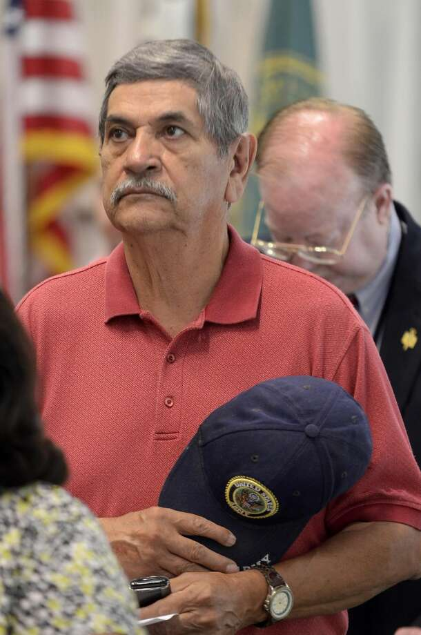 Military veteran Salvador Muños participates in a moment of silence for fallen members of the Armed Forces at Laredo Community College's Memorial Day Observance Thursday morning. (Cuate Santos/Laredo Morning Times)