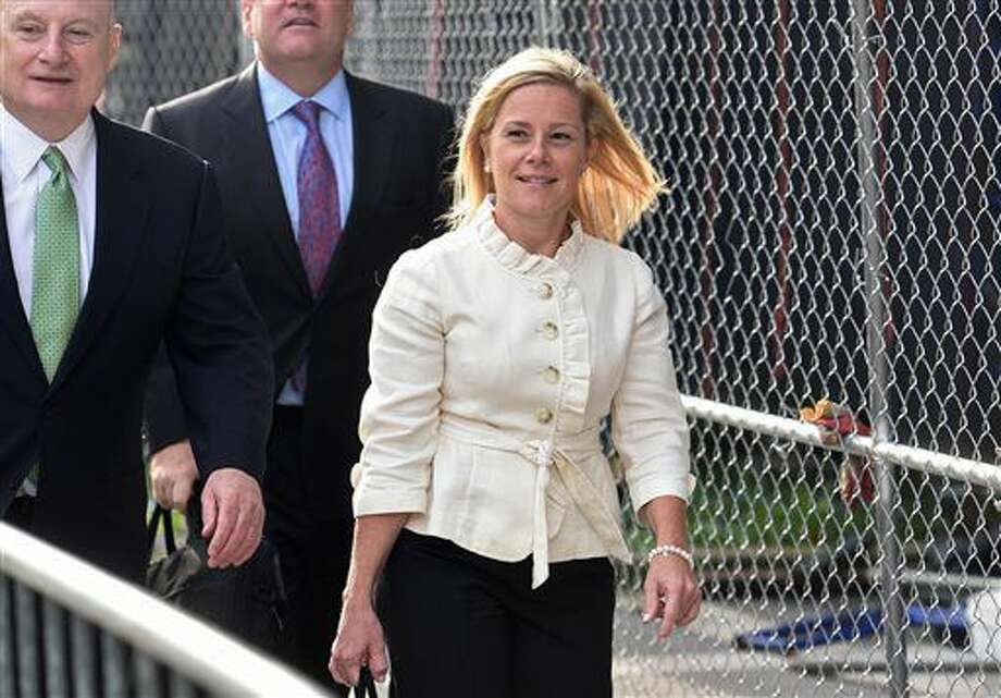 Bridget Kelly enters the courthouse for the start of the trial, Tuesday, Sept. 20, 2016 in Newark, N.J. Bill Baroni, a Port Authority of New York and New Jersey official, and Bridget Kelly, Christie's former deputy chief of staff, are charged with civil rights violations, conspiracy and wire fraud. Prosecutors say they caused the traffic jams by reducing the number of access lanes to the bridge from three to one without notifying Fort Lee officials. (Chris Pedota/The Record via AP)