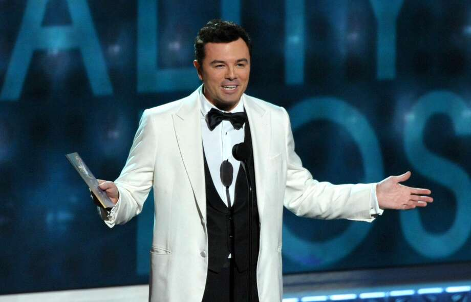 This Sept. 23, 2012 file photo shows Seth MacFarlane presenting an award at the 64th Primetime Emmy Awards at the Nokia Theatre in Los Angeles. Macfarlane will host the 85th Academy Awards on Sunday, Feb. 24, 2013 on the ABC Television Network. (Photo by John Shearer/Invision/AP, file)