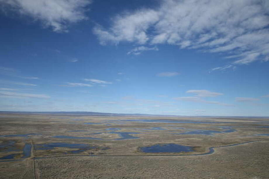 FILE - This March 23, 2016, file photo shows part of the Malheur National Wildlife refuge outside of Burns, Ore. Hundreds of national wildlife refuges that provide critical habitat for migratory birds and other species are crippled by a staffing shortage that has curtailed educational programs, hampered the fight against invasive species and weakened security at facilities that attract nearly 50 million visitors annually, a group of public employees and law enforcement said Wednesday, Sept. 21, 2016 (Dave Killen/The Oregonian via AP, File)