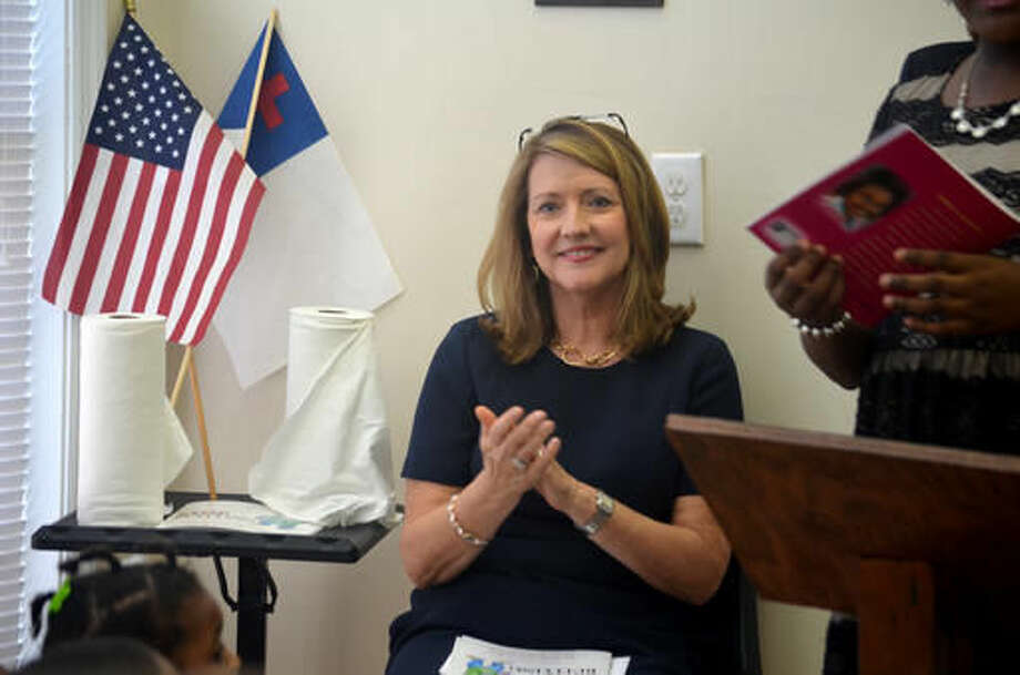 "In this Wednesday, Sept. 22, 2016 photo, Tennessee first lady Crissy Haslam applauds at the climax of 12-year-old author Robyn Gordon's book ""Stop Bullying"" where the protagonist finds a way to solve his bullying problem, after wrapping up a reading session with students of Power and Grace Preparatory Academy, in Clarksville, Tenn. (Pranaav Jadhav /The Leaf-Chronicle via AP)"