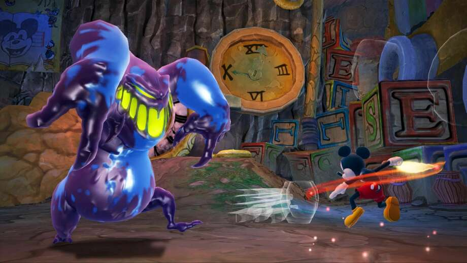 "This undated publicity file photo provided by Disney shows Mickey Mouse using a paintbrush to fight a monster in ""Epic Mickey 2: The Power of Two,"" (Disney, for the Xbox 360, PlayStation 3, $59.99; Wii U, $54.99; Wii, $49.99). The interactive arm of the Walt Disney Co. announced Tuesday, Jan. 29, 2013, that it is closing Junction Point Studios. The Austin, Texas-based video game developer created 2010's ""Disney Epic Mickey"" and its 2012 sequel ""Epic Mickey 2."" (AP Photo/Disney)"