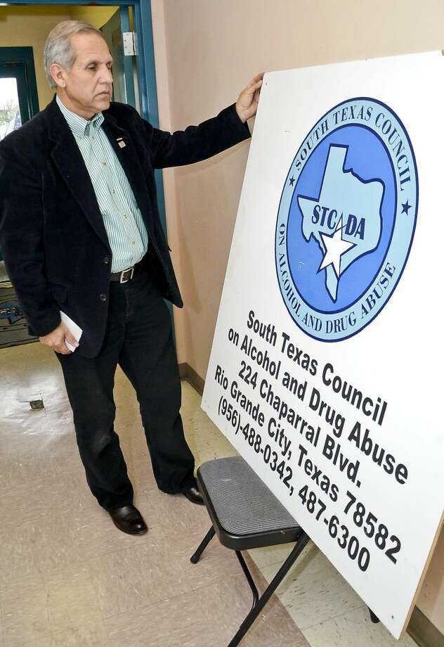Romeo Rodriguez, executive director of STCADA, shows a sign that once stood outside of the STCADA office at Rio Grande City back in December, at the Laredo office. The organization will cease operations Friday, when remaining agency materials will be raffled or sold off. (Danny Zaragoza, File/Laredo Morning Times)