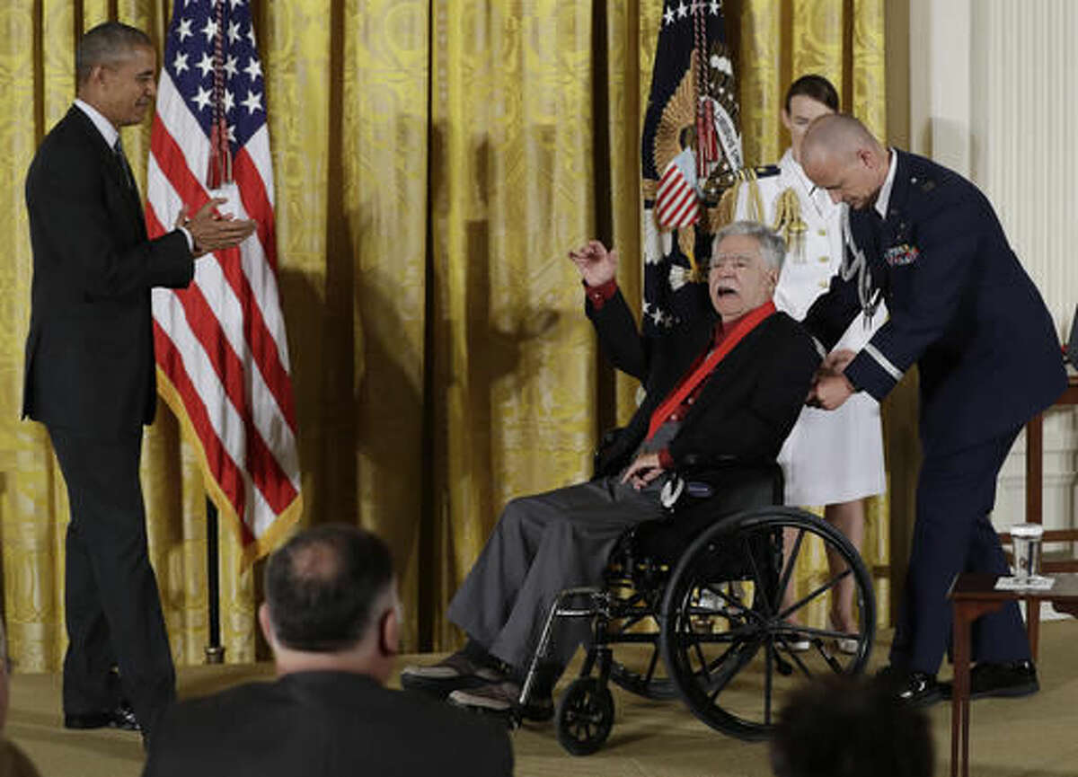 President Barack Obama looks to author Rudolfo Anaya as he calls out after being awarded the 2015 National Humanities Medal during a ceremony in the East Room of the White House, Thursday, Sept. 22, 2016, in Washington. (AP Photo/Carolyn Kaster)