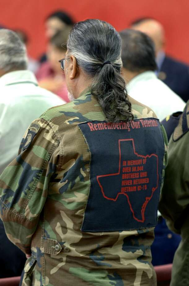 A Vietnam War veteran wears a message on his military jacket honoring more than 58,044 soldiers who never returned from the conflict. Faculty and students, war veterans and local officials participated in a Memorial Day ceremony Friday morning at Memorial Middle School. (Photo by Cuate Santos/Laredo Morning Times)