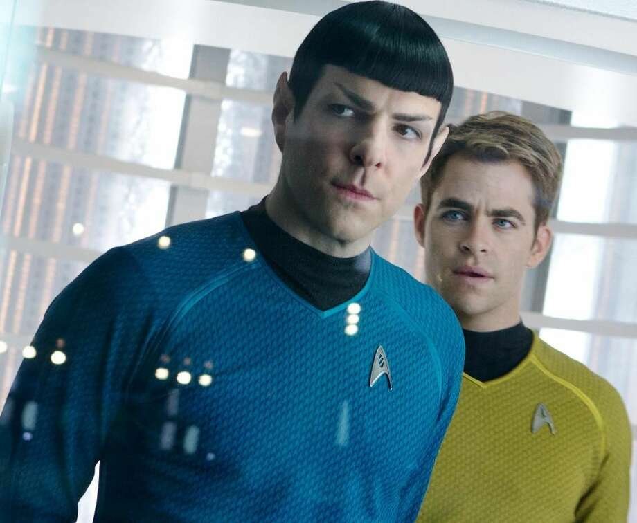 "This undated publicity film image released by Paramount Pictures shows Zachary Quinto, left, as Spock and Chris Pine as Kirk in a scene in the movie, ""Star Trek Into Darkness."" AP Photo/Paramount Pictures"