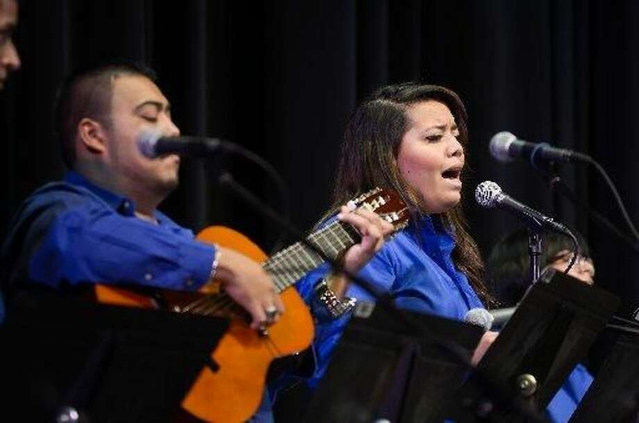 """Felipe Suarez and Melissa Vallejo and the rest of the Laredo Community College Spanish Traditional Group perform the classic spanish ballad """"Amor Eterno"""" for an audience of mothers and their families on Sunday afternoon at the Laredo Community College Guadalupe and Lilia Martinez Fine Arts Center theater. (Photo by Danny Zaragoza"""